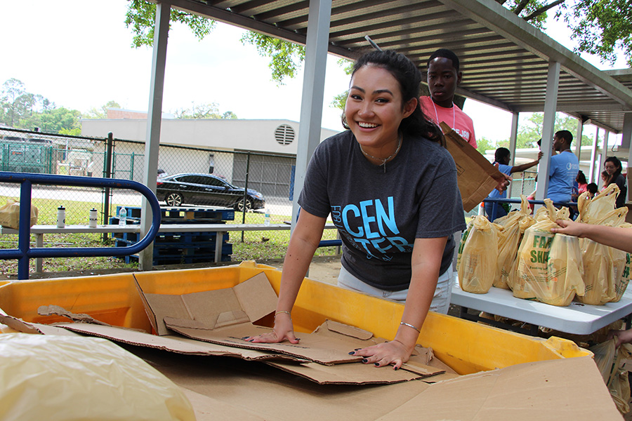 Florida State University students and PeaceJam Conference attendees from across the Southeast work with FarmShare to prepare a truckload of food for distribution at Sabal Palm Elementary School Saturday, April 6, 2019.