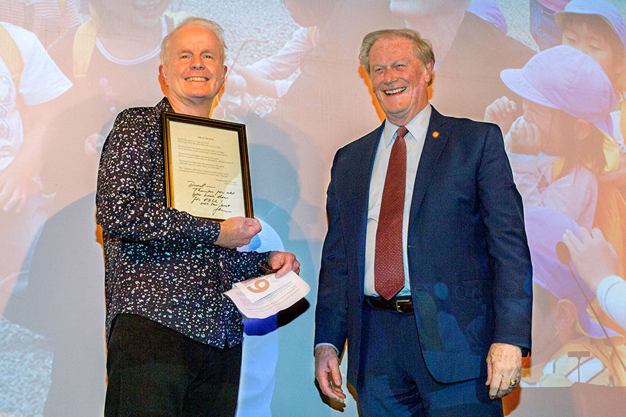 President Thrasher recognizes David Kirby at the annual English department awards, April 12, 2019. (FSU Photography Services)