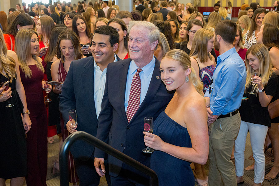 FSU President John Thrasher poses for a picture with graduating students at the 2019 President's Senior Toast. (FSU Photography Services)