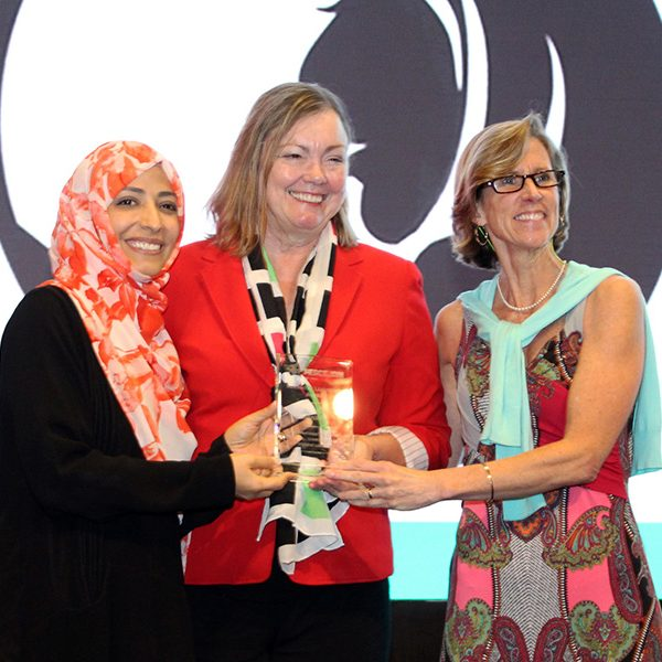 Provost Sally McRorie (middle) accepts the PeaceJam Foundation's inaugural Innovative Leadership Award from Nobel Peace Prize laureate Tawakkol Karman and Kate Cumbo, the executive director of the PeaceJam Foundation.