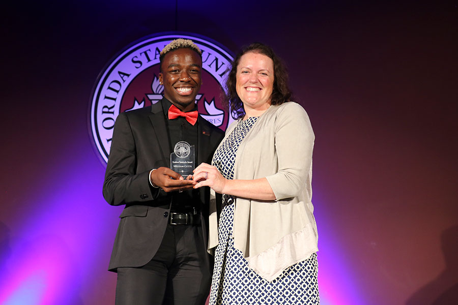William Cutts accepts a Student Seminole Award from Associate Vice President for Student Affairs Allison Crume at the Leadership Awards Night April 9, 2019. (Photo: Division of Student Affairs)