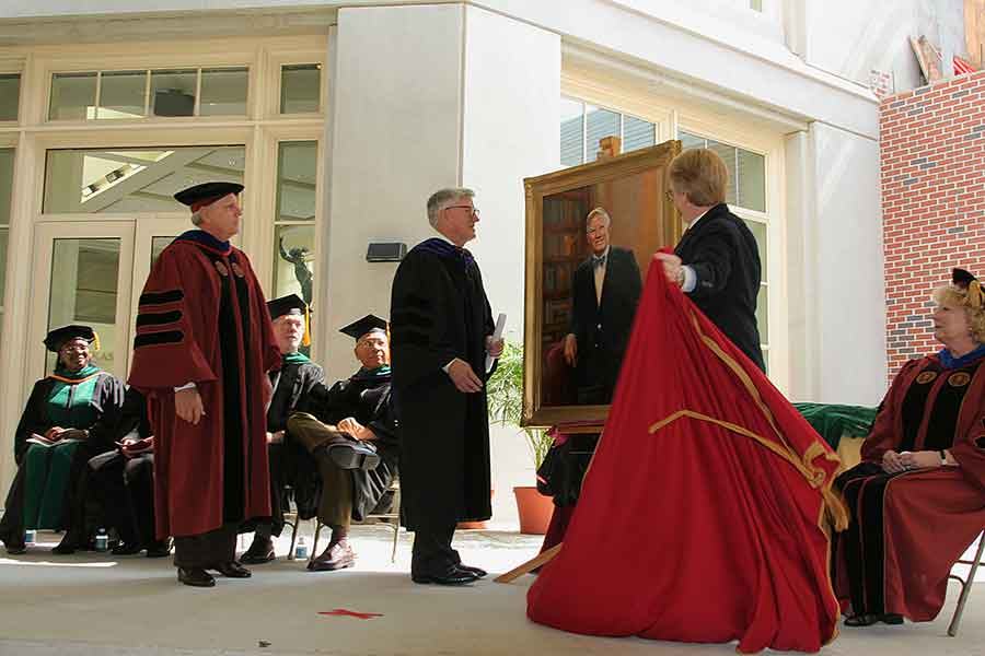 A portrait of President Emeritus Sandy D'Alemberte is revealed during the College of Medicine's inaugural commencement ceremony in 2005. (FSU Photography Services)