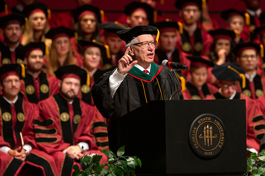 Commencement speaker Michael Muszynski, retiring dean of the Orlando Regional Campus, addresses graduates at FSU College of Medicine commencement May 18, 2019. (FSU Photography Services)