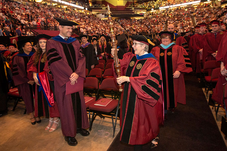 Professor Susan Fiorito, director of the Jim Moran School of Entrepreneurship, led the procession into commencement ceremonies. (FSU Photography Services)
