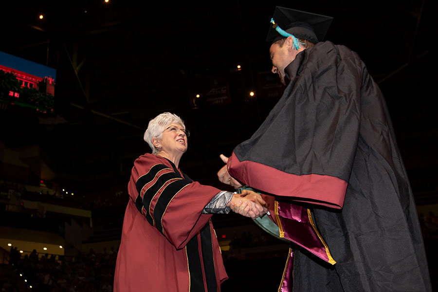 Jan Moran congratulates Cory Witt, the first graduate of the Jim Moran School of Entrepreneurship, during FSU's spring commencement Friday, May 3, 2019.