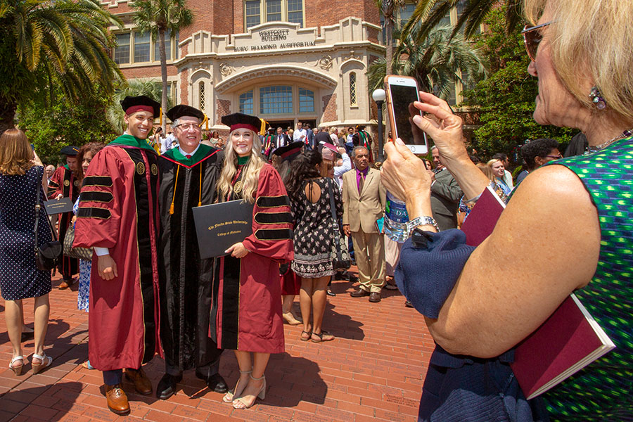 Newly minted doctors celebrate after Florida State University College of Medicine's commencement ceremony May 18, 2019. (FSU Photography Services)