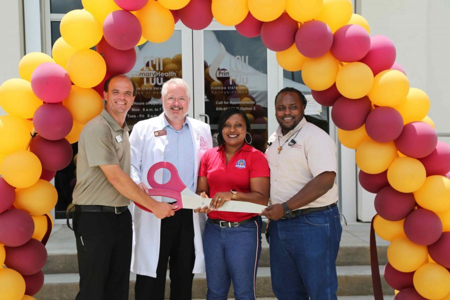(Left to right) Jason Rybicki, vice president of FSU PrimaryHealth's community advisory board; Daniel Van Durme, senior associate dean for clinical and community affairs; Anicia Robinson, principal of Sabal Palm Elementary; and Johnnie Seals, a neighborhood resident and job-site superintendent for Childers Construction, cut the ribbon at the College of Medicine's new primary-care health health center, FSU PrimaryHealth.
