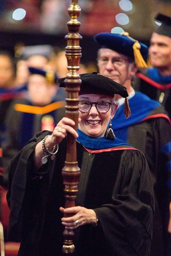 Professor Susan Fiorito, director of the Jim Moran School of Entrepreneurship, leads the procession at the 2018 summer commencement. (FSU Photography Services)