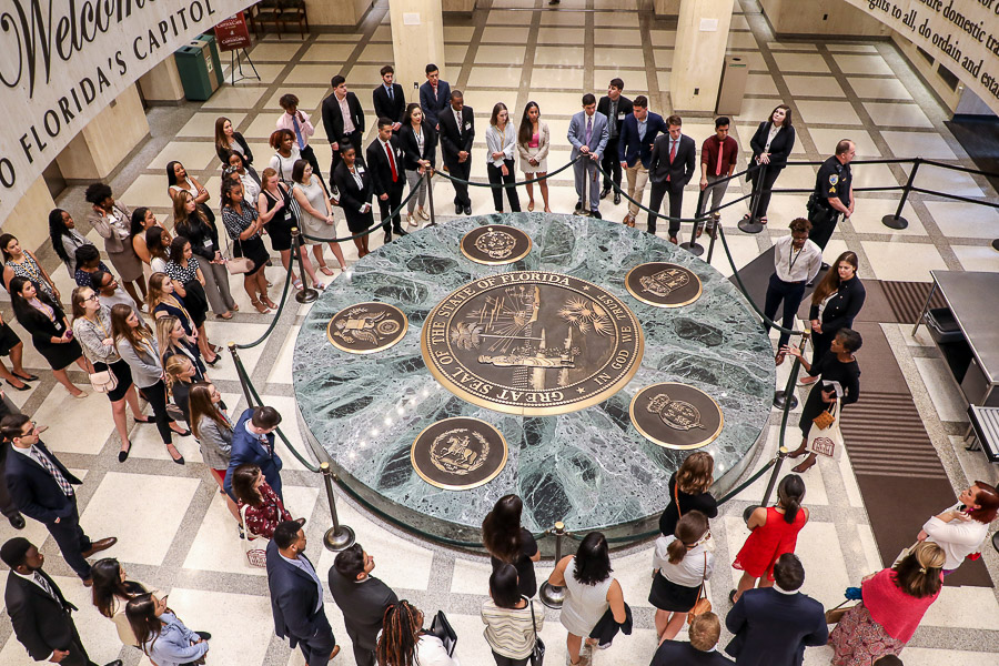 Students pause in the Capitol Rotunda at the entrance of the state Capitol.