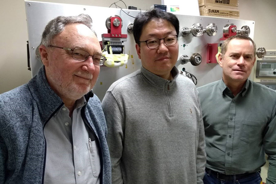 MagLab researchers David Larbalestier, Seunyong Hahn and Iain Dixon developed a magnet that generated a 45.5 tesla magnetic field.