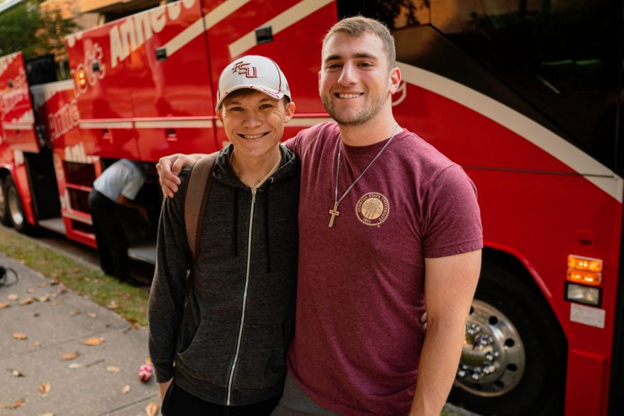 Band members Chase Davis (L) and Alex Arbeiter (R) pause for a photo on campus before boarding buses traveling to Atlanta for a nonstop flight to Paris. Nearly 400 band members traveled to France to help commemorate the 75th anniversary of D-Day. (June 3, 2019)