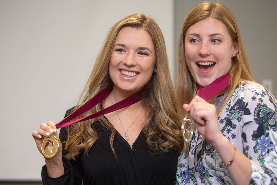 Students Ashley Falzoi (L) and Linnea Blackmore (R) pose with their medals at the Summer 2019 Garnet & Gold Scholars induction ceremony. (FSU Photography Services)