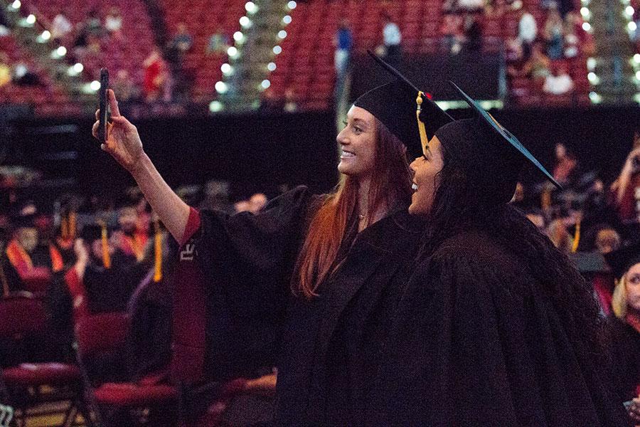 Graduates pose for a