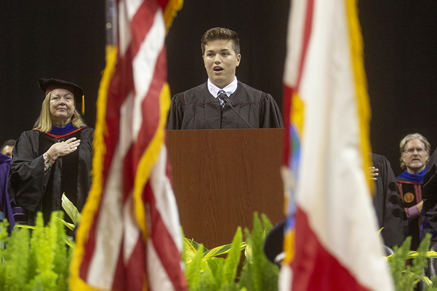 Freshman Conner Fabrega performed the Hymn to the Garnet and Gold at New Student Convocation Sunday, Aug. 25, at the Donald L. Tucker Civic Center. (FSU Photography Services)