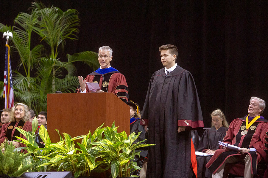 Professor Kevin Fenton and freshman Conner Fabrega perform the Hymn to the Garnet and Gold at New Student Convocation Sunday, Aug. 25, 2019, at the Donald L. Tucker Civic Center. (FSU Photography Services)