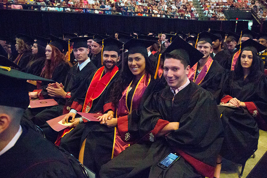 Graduates smiles for the camera at summer commencement Saturday, Aug. 3, 2019. (FSU Photography Services) ent Friday, Aug. 2, and Saturday, Aug. 3, 2018, at the Donald L. Tucker Civic Center. (FSU Photography Services)