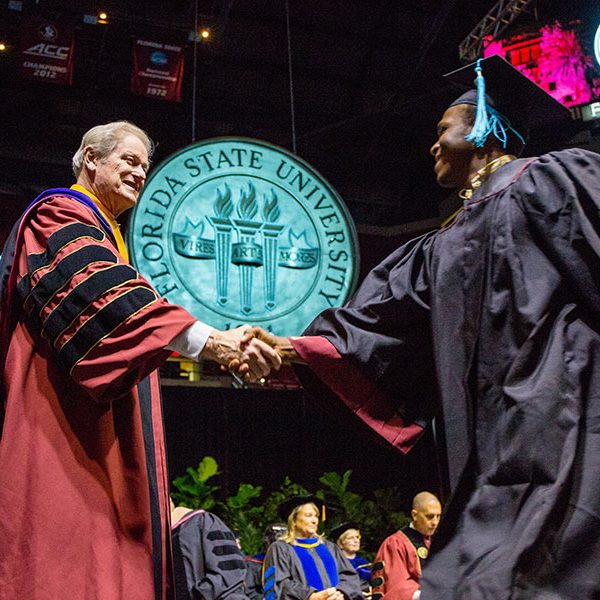 President John Thrasher congratulates graduates at summer commencement Saturday, Aug. 3, 2019. (FSU Photography Services)