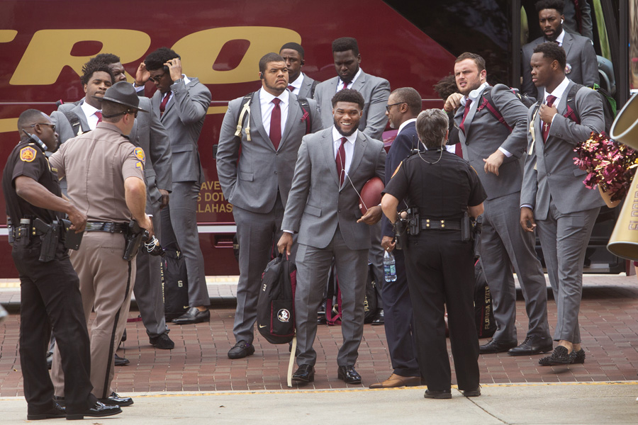 FSU Football players arrive at the Legacy Team Walk before the Louisville game Sept. 21, 2019. (FSU Photography Services)