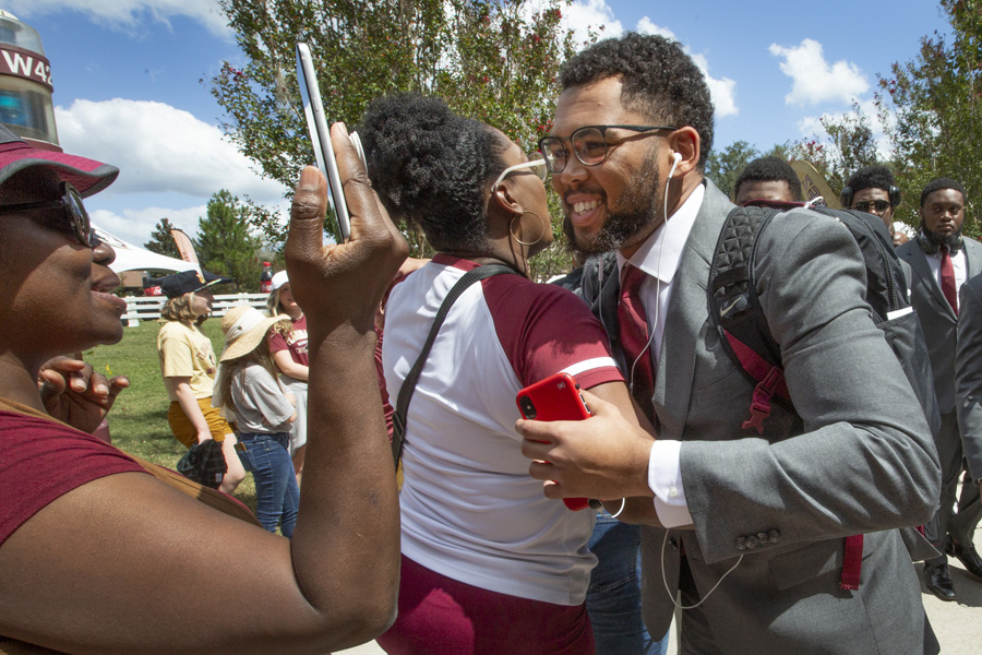 FSU Football players greet fans at the Legacy Team Walk before the Louisville game Sept. 21, 2019. (FSU Photography Services)