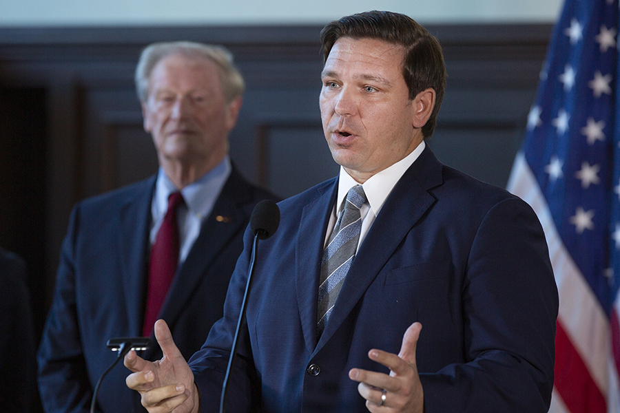 Gov. Ron DeSantis applauds FSU's faculty, staff and students on the university's rise to No. 18 in the U.S. News & World Report rankings of national public universities during a news conference Sept. 9, 2019. (FSU Photography)