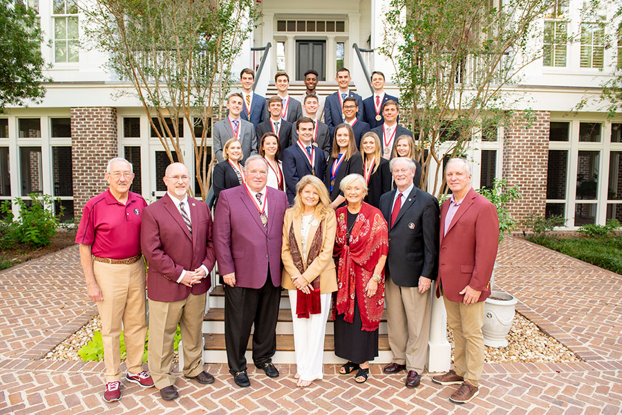 James and Martha Seneff with inaugural cohort of the FSU College of Business' James M. Seneff Scholars on Saturday, Sept. 28, at a celebratory event hosted by President John Thrasher and First Lady Jean Thrasher at the FSU President's House in Tallahassee. (Pictured from left) Back row: Cole Bakotic, Andrew Colvin, Kenneth Frazier, Michael Ramsey, Dexter Bell; Second row: Cameron Strickler, Matthew Williams, Christian Glover, Carlos Rodriguez, Alexander Suriano; Third row: Ivy Van Dyke, Judith Wieland, Matthew Hader, Katherine Newcomb, Mary Katherine Marasco and Sophia Metallo; Front row: FSU Board of Trustees member Mark Hillis, College of Business Dean Michael Hartline, James M. Seneff, Martha Seneff, FSU First Lady Jean Thrasher, FSU President John Thrasher and FSU Board of Trustees Chairman Ed Burr.