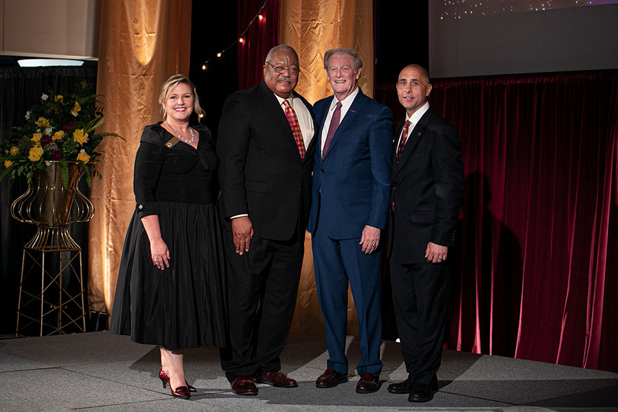 FSU Alumni Association President Julie Cheney, Melvin Stith, President John Thrasher and Alumni National Board of Directors Chair Sam Ambrose.