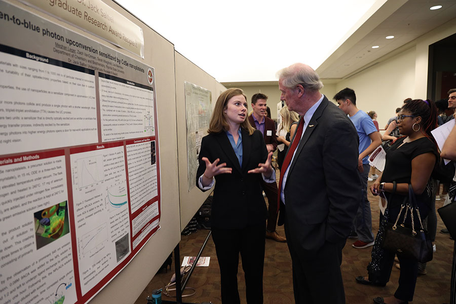 Junior Meghan Leger explains research to FSU President John Thrasher. (Bayard Stern)