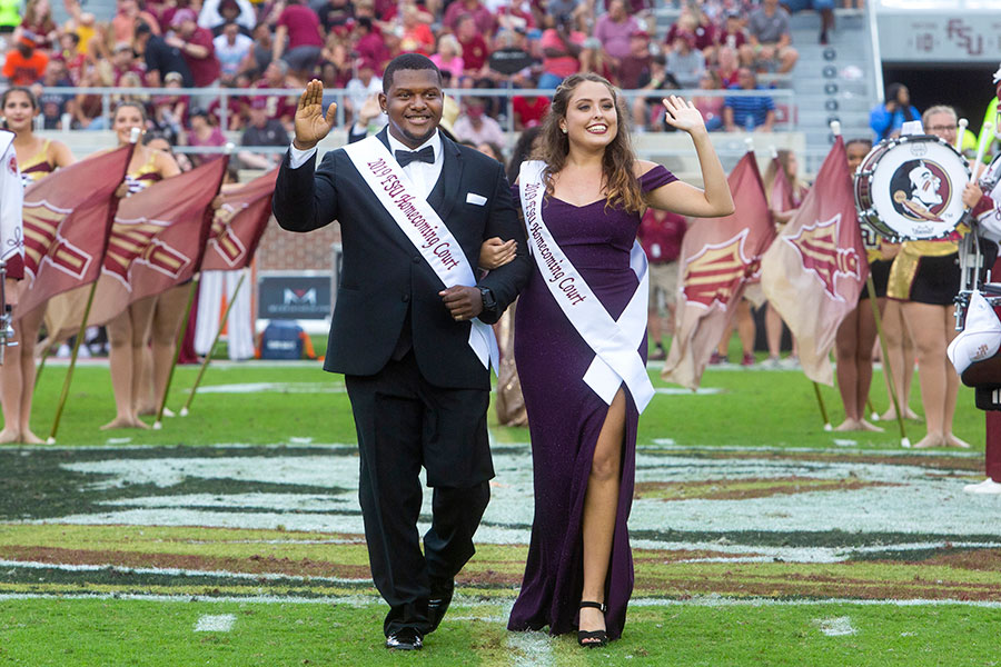 Homecoming court members Kai Tillman and Riley Torrence during the Syracuse football game Saturday, Oct. 26, 2019. (FSU Photography Services)