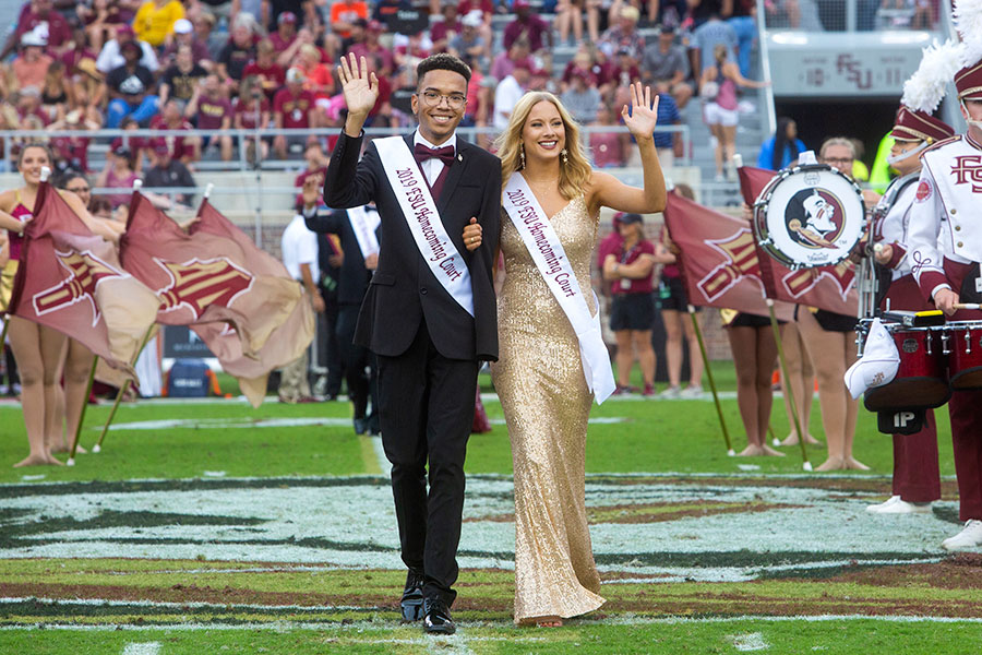 Homecoming court members Demetrius Winn and Jayne McLaughlin during the Syracuse football game Saturday, Oct. 26, 2019. (FSU Photography Services)