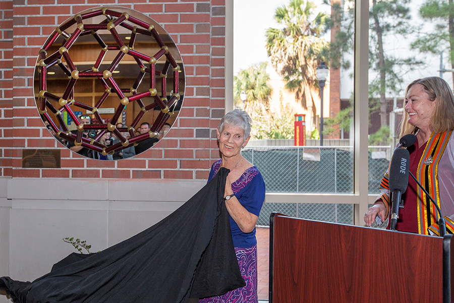 Margaret Kroto unveils a sculpture of a buckyball with Provost Sally McRorie.