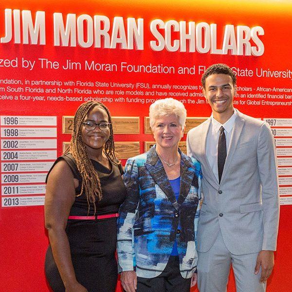 2019 Jim Moran Scholars Kiara Guerrier and Alejandro Robins with Jan Moran during a reception Wednesday, Oct. 16, 2019, at the Jim Moran Building in Tallahassee. (FSU Photography Services)