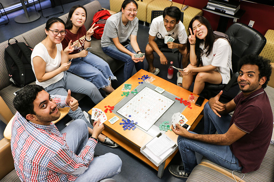 Students play cards in the student lounge at FSU's Center for Intensive English Studies.