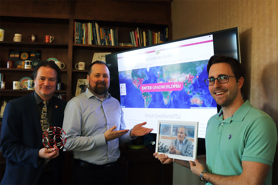 Mark Riley, dean of The Graduate School; Rodney Johnson, assistant director of Creative Services for Web; and James Beck, The Graduate School, show off the new GradWorld FSU.