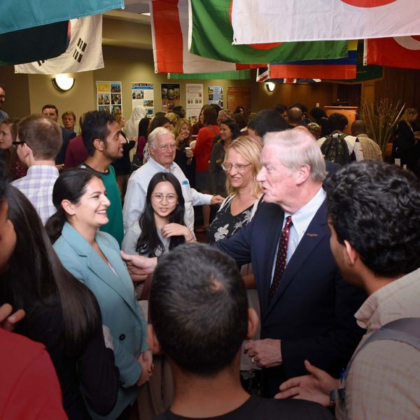 President Thrasher meets with students during the opening reception of International Education Month.