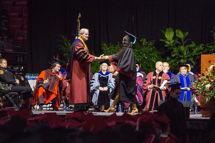 President John Thrasher congratulates graduates during FSU's 2019 fall commencement. (FSU Photography Services/Bill Lax)