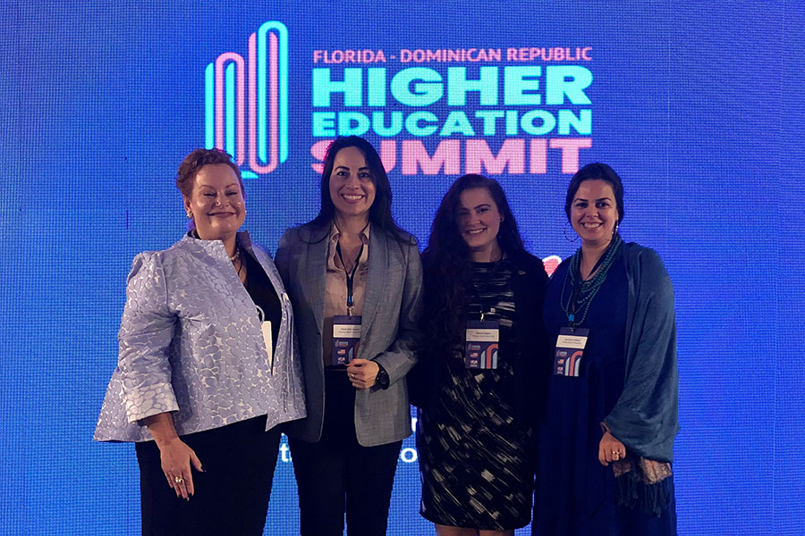 (From left) Professor Audrey Casserleigh, Florida A&M faculty member Paula Gomez, FSU doctoral student Becca Rogers, Associate Professor Lara Perez-Felkner (far right) with colleagues at the Florida-Dominican Republic Higher Education Summit.