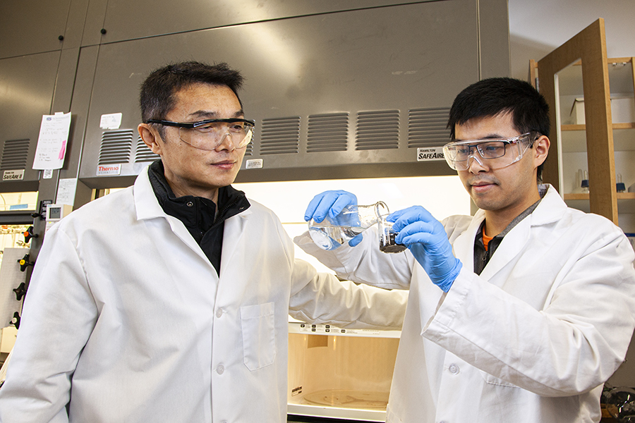 Gang Chen, left, a professor of Civil & Environmental Engineering at the FAMU-FSU College of Engineering and research assistant Runwei Li work on research separating heavy metals from human waste solids in the lab at the Aero-Propulsion, Mechatronics, and Energy (AME) building in Tallahassee, Florida.