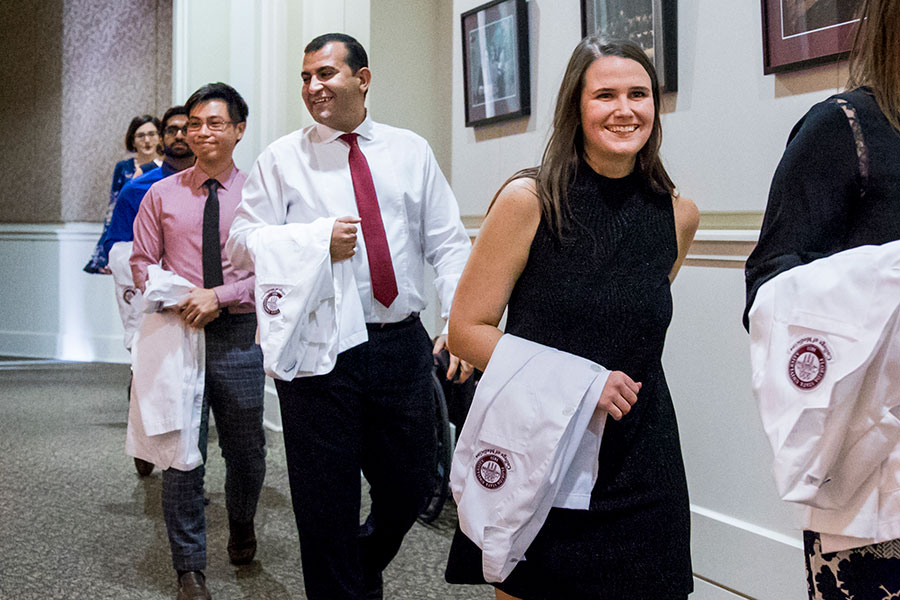 Tamer Tadros (middle) is one of 37 members of FSU's School of Physician Assistant Practice first graduating class.