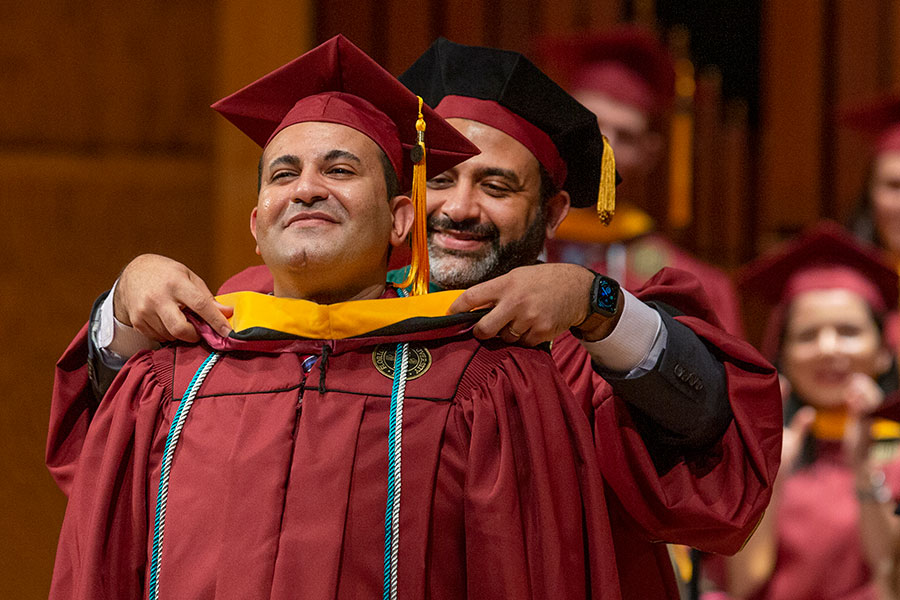 Tamer Tadros being hooded by his brother, Basim Tadros, who is a physician with Southern Medical Group in Tallahassee, as the first graduates of the FSU School of Physician Assistant Practice celebrate commencement Saturday, Dec. 14. (FSU Photography Services)