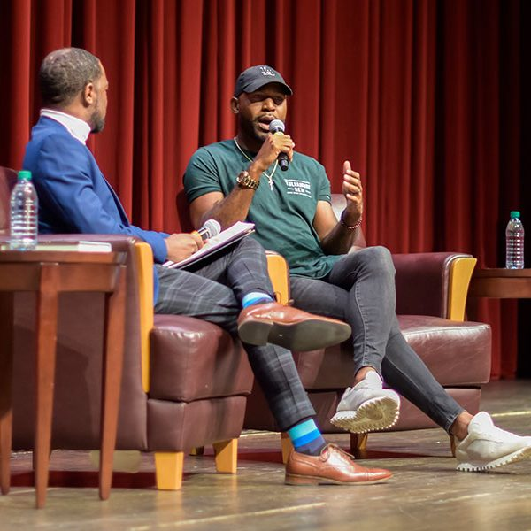 Karamo Brown (R) engaged in a conversation moderated by Assistant Professor Cameron Beatty (L) at the 32nd Annual MLK Commemoration Celebration. (Emily Chavarie)