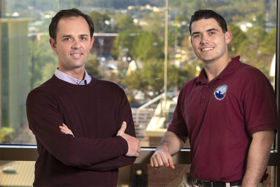 From left, Christopher Holmes, the Werner A. and Shirley B. Baum assistant professor of meteorology in the Department of Earth, Ocean, and Atmospheric Science at Florida State University, and Jason Ducker, a postdoctoral researcher. Their research compared levels of atmospheric ozone to the amount of ozone plants took in through pores on their leaves at more than 30 sites over 10 years. They found that environmental factors have more impact on the ozone dose the plants received than the amount of ozone in the atmosphere. (Bruce Palmer / FSU Photography Services)