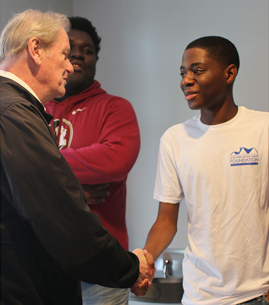 President Thrasher greets SSF students at the new house Saturday, Jan. 11.