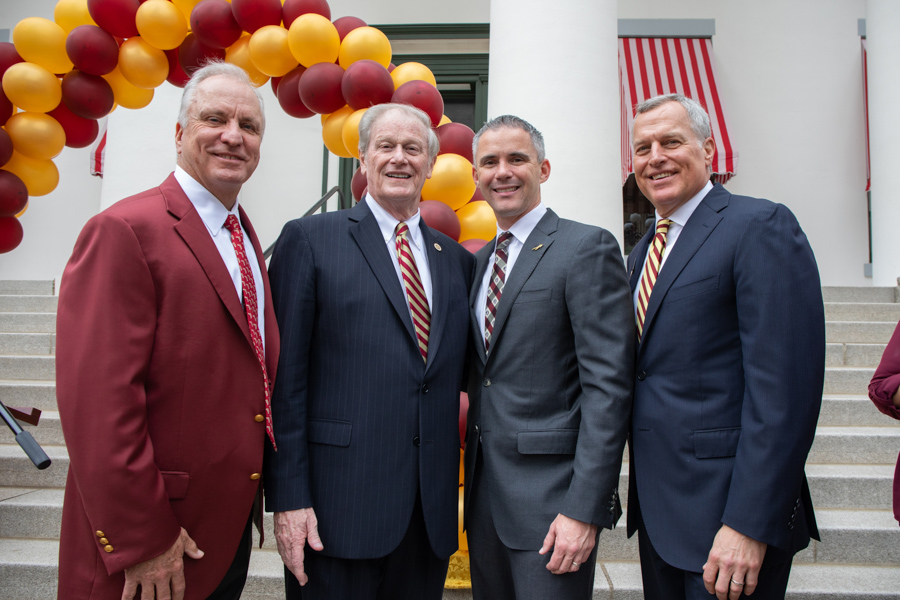 (L to R) Ed Burr, Chair of the FSU Board of Trustees, President Thrasher, Mike Norvell, FSU Football Coach and John Thiel, FSU Board of Trustees. (FSU Photography Services)