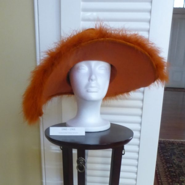 """Orange!"" Schofield said of this ""slouch"" hat, which dates to the 1960s. ""It's kind of wrinkled, kind of slouchy. It's got some feathers on it. But in thinking about the 1960s, you've got long, straight hair. It's not dissimilar from the 1920s with no-volume hair."""