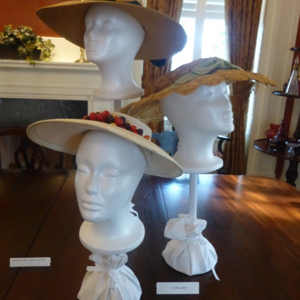 "These ""cartwheel"" hats date to the 1930s. ""The materials here have moved from velvet to straw and other, lighter materials. They're round, they sit back on the head and there's more room for hair. Hair was still shorter at the time but it also had some volume to it. So, the hats allowed the hair to do its own thing."""