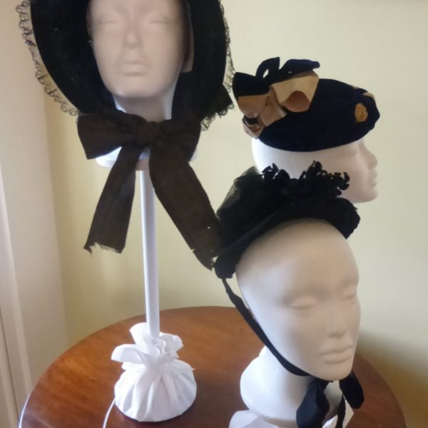 "All three of these hats are bonnets, dating from the 1890s through 1910. The bonnet had a very specific purpose with respect to conveying social status, Schofield said. ""If you were tanned, that meant you were working in the field. If you had wealth and status, you didn't get sun at all. In that respect, there is a level of social class here,"" Schofield said."