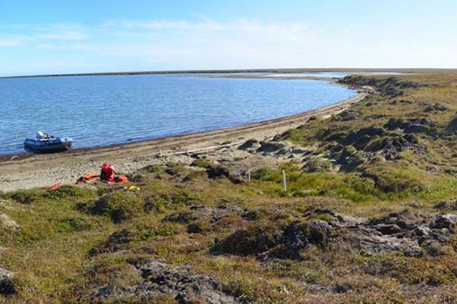 A view of one of the research team's study sites near Kaktovik, Alaska. Shallow groundwater flows beneath the tundra surface into the adjacent lagoon. Photo by: M. Bayani Cardenas / University of Texas at Austin