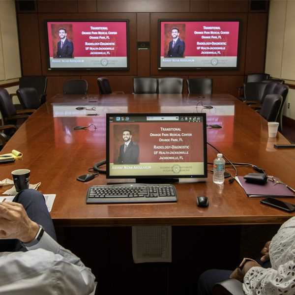 Dr. John P. Fogarty, dean of the College of Medicine, and Dr. Alma Littles, senior associate dean for Medical Education and Academic Affairs, watch the college's Match Day Ceremony online. Due to concerns about the global COVID-19 pandemic, the medical school replaced its annual on-campus ceremony with a virtual event. Photo by: Bruce Palmer / FSU Photography Services
