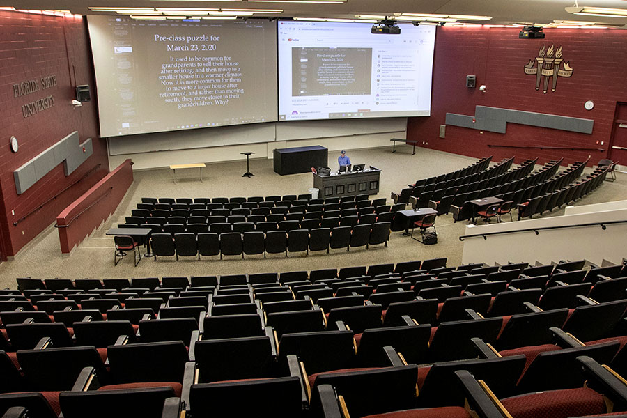 Michael Hammock, an assistant teaching professor of economics, taught his class via YouTube in the vacant lecture hall that holds 500 students. (FSU Photography Services/Bruce Palmer)