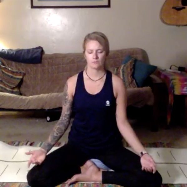 Instructor Alex Nolte teaches her yoga class remotely.
